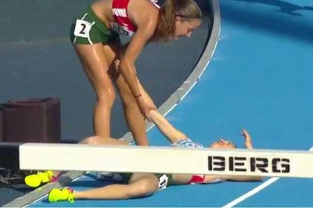 Magyar futó segít elesett társának